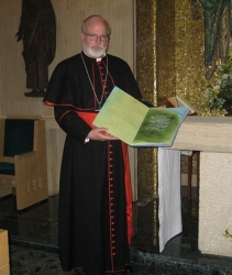 Cardinal Sen P. O'Malley holds a book containing over 1,000 names of known Boston victims of clergy sexual abuse that was presented to Pope Benedict XVI at a meeting between the Holy Father and five survivors of sexual abuse by clergy April 17. Pilot photo/Courtesy Barbara Thorp